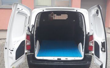 Plastic floor in the cargo compartment of the van