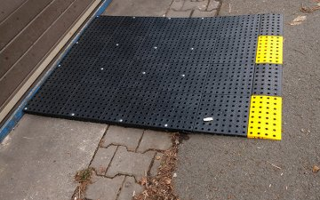 Plastic mobile ramp to the warehouse
